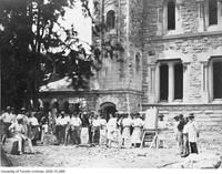 Stone carvers and construction workers in front of University College.