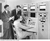 Gordon Slemon and Douglas Andrews with reactor simulator
