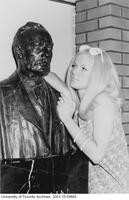 Female student posing with bust of John Galbraith