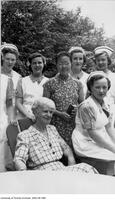 Nursing students from the 1945-49 class with Ms. Russell in the garden