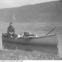 Harold Innis in canoe on Peace River