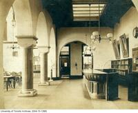 Library, circulation desk, 1892-1910, looking east with reading room door at left