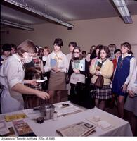 Students observe experiment during an open house at the the School of Nursing