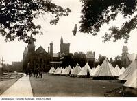 Royal Flying Corps, tents on back campus with airplane overhead.