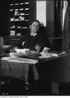Hugh Hornby Langton, librarian sitting at desk
