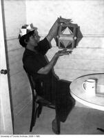 Mathematician George Odom showing a geometric model