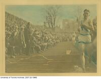 John Ratcliff (Jack) Naden finishing the intercollegiate one-mile relay in Varsity Stadium on Oct. 19, 1923