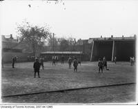 University of Toronto Schools - students on athletic grounds playing baseball