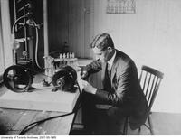 Prof. A.G. Hunstman working in laboratory