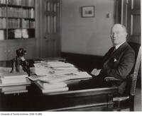President Robert Falconer sitting at desk