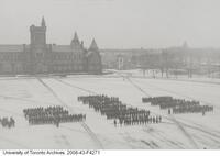 Canadian Officers Training Corps drill on a snowy front campus, University of Toronto.