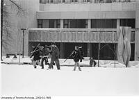 Hockey players crossing front campus