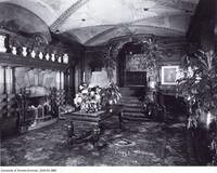 Interior view of Holwood (Flavelle House), 78 Queen's Park Crescent, showing the paneled room.