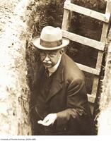 William A. Parks, head of the Department of Geology and director of the Royal Ontario Museum seen in trench