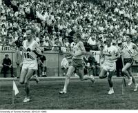 Australian Pat Clohessy, Bruce Kidd, Charlie ?, Chris Williamson in a race at the C.N.E. Labour Day Invitational Meet, Toronto.