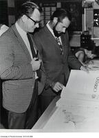 William Dean and ? Matthews look over the Economic Atlas of Ontario?