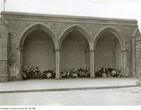 Flowers in front of memorial tablets, Nov. 11, 1930
