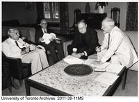 President Ham, along with the president's of the federated colleges, sign the Memorandum of Agreement, April 1984.