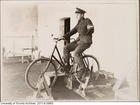 Returned WWI soldier in rehabilitation in Hart House - shown here on stationary bicycle