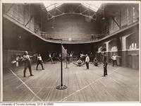 Returned WWI soldiers in rehabilitation in Hart House - seen here playing badminton in the gymnasium