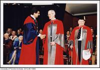 Dr. James Till shaking President Naylor's hand after having received an Honorary Degree from the University of Toronto June 9 2004