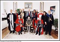 Convocation officials, June 9, 2004. Dr. James Till and Dr. Ernest McCulloch are seated on either side of Chancellor Vivienne Poy.