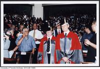 Dr. James Till and Dr. Ernest McCulloch exiting Convocation after having been awarded an Honorary Degree from the University of Toronto June 9 2004