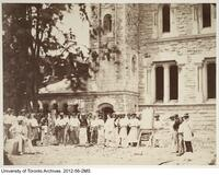 Construction of University College: group of carvers in front of the architect's office at the west end of the south wing.