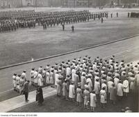 Remembrance Day Ceremony on front campus in 1941 showing University of Toronto Canadian Officers Training Corp and women cadets.