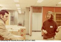 Richard Landon of the Rare Book Department, directing the move to the new library at 120 St. George Street.