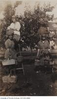 "Women fruit pickers ""farmerettes"" at the Government Experimental Farm in Vineland Ontario in the summer of 1918."