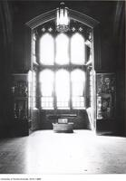 Hart House east staircase and landing, showing machine gun and trophy case.