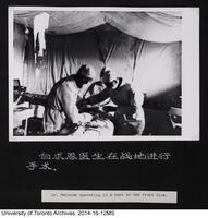 Dr. Bethune operating in a tent on the front line.