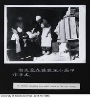 Dr. Bethune operating in a small temple at Sun Chia Chuang.
