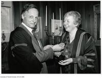 University Professor John Polanyi presents his Nobel Prize to Prof Ann Saddlemyer, master of Massey College, Feb. 27 1989