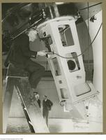 Charles A. Chant, professor of Astronomy, in position for observing with the spectrograph, May 30 1935