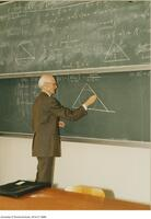 Donald Coxeter, world famous geometer, seen here lecturing at the chalk board.