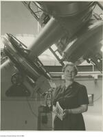 Astronomer, Helen Sawyer Hogg beside the of the David Dunlop optical telescope