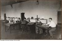 World War I rehabilitation in Hart House - shown here patients with physiotherapists.