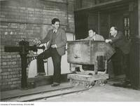 Student Mining Engineers with mining bucket on rail, University of Toronto