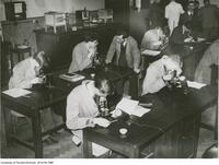 Student Mining Engineers at microscopes, University of Toronto