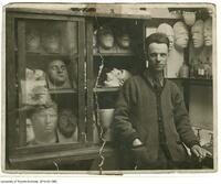 Frederick Coates with plaster facial models