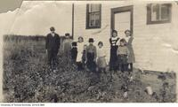 Harold Innis with pupils in front of schoolhouse, Landonville Alberta.