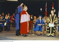 Joseph L. Rotman, honorary degree recipient, being hooded.