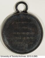 University of Toronto silver medal in Classics presented to 1877 University College graduate, James E. Wetherell. (back side)