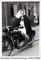 Canadian World War II nursing sister, Irene Mick, on motorbike