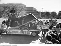 "1968 Homecoming Float Parade - Architecture student power themed ""Claude-hopper"" float"