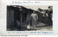 """A western Canadian hotel - Mr. and Mrs Moore and Marie outside their """"stopping place"""""""
