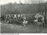 Engineers on pontoon bridge