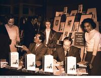 "Eric Aldwinkle and Morley Callaghan autographing copies of ""The Varsity Story"""